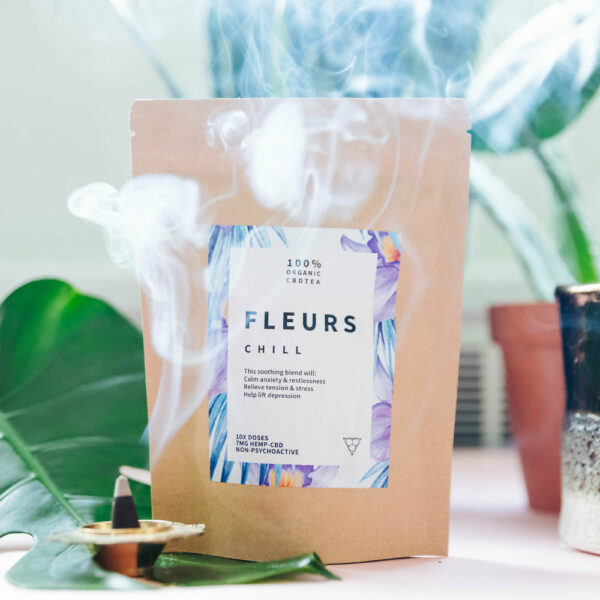A bag of Felurs CBD Tea Chill with incense burning.